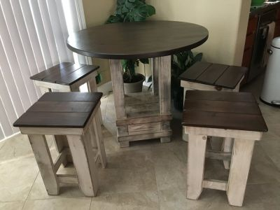 Solid wood bar height table and 4 stools, like new
