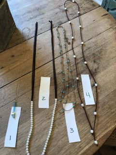 4 necklaces for $20 or will sell individually for $5 each