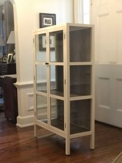 Glass front cabinet with shelves