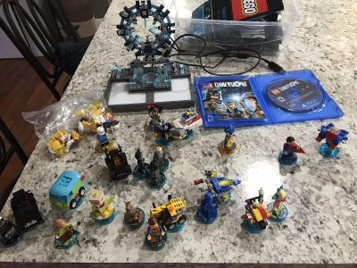 Lego dimensions for PS4 with 8 level packs. $75