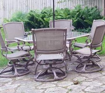 6 Sided Patio Table w 6 Rocking Swivel Chairs and 2 Ottomans