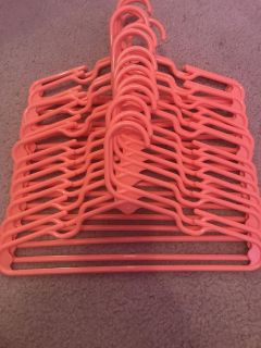 18 coral colored kids size hangers