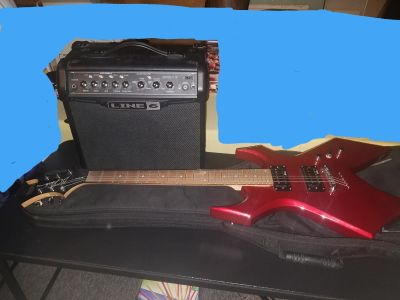 Warlock guitar with case and amp