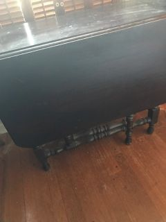 Black Lacquered Drop Leaf Table. OPens for dining 2 leafs.