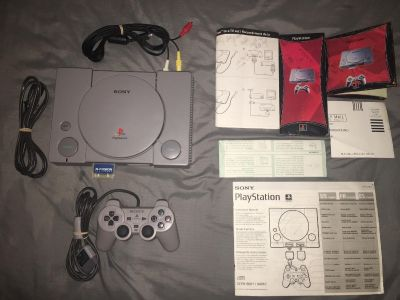 Never used, open box Mint Sony PlayStation with tons of extras
