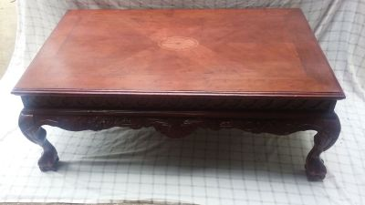 Solid wood table with claw feet