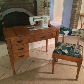Sewing machine desk, chair and machine. Something is wrong with machine