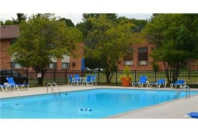 Visit Apartments and you will find a quiet wooded setting on 30 acres. Parking Available!