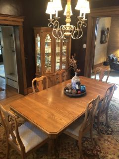 Dining room table and lighted hutch
