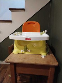 Fisher Price high chair, attaches to regular dining chair. Stains on the straps.