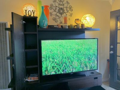 """Mint condition entertainment center with shelves and large drawers. Fit a big screen up to 50"""" b..."""