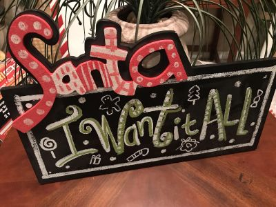 17 long by 12 tall at tallest point , wood with glitter , super cute !!! Has a bow to hang with