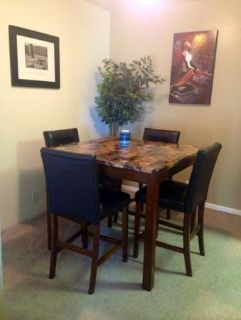 Beautiful Tall Dining Table  four comfortable chairs