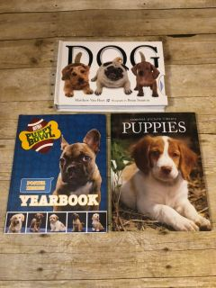 Dog lover lot puppies book is hardback, DOG book is hardback amd also has touch and feel as well as pull tab pages like wagging heads $6