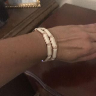 White stretchy bracelet with gold overlay