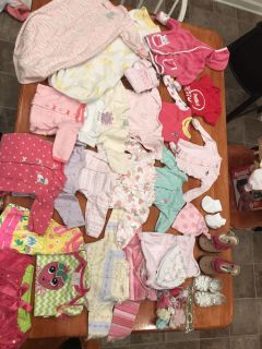 Diaper bag full of NB, 0-3, & 3-6 month winter clothes