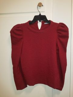 Red top with ruffled sleeve