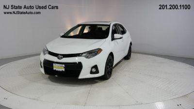 2016 Toyota Corolla L (super white)