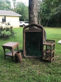 Brown wicker mirror with side tables