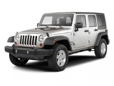 2011 Jeep Wrangler Unlimited Sahara (Deep Cherry Red Crystal Pearl Coat)