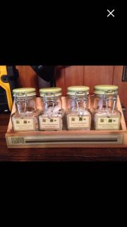 Glass Small Canisters in a Wood Shelf