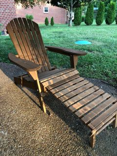 Wooden Adirondack chair with pull-out ottoman