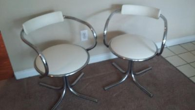 1960's Vinyl and Chrome swivel chairs