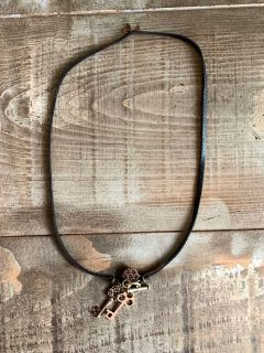 Leather necklace with key tokens length from end to end is approximately 30 Excellent condition!