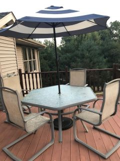 Table, 4 chairs and umbrella