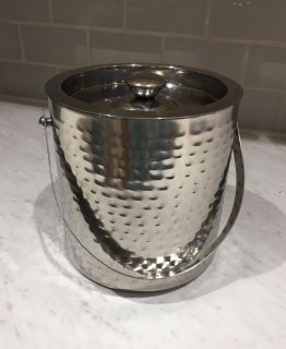 Hammered silver-tone ice bucket with ice tongs