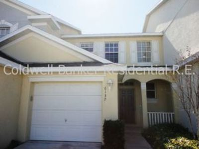 Large Townhome with Garage Located in a Gated / Pool Community with Gym. Free Water & Sewer