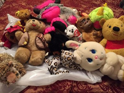 Lot of stuffed animals. Most are vintage. Pooh is well loved but still winds up and plays the tune