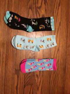 New kids socks dogs and cats, dogs, and smaller pair with flamingos. All three for $4. Gallatin unless going to H ville.