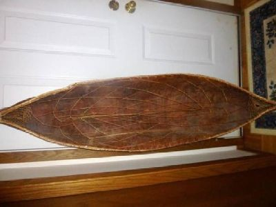 $550 OBO 6 ft birch bark canoe with dream catcher weaved in the middle