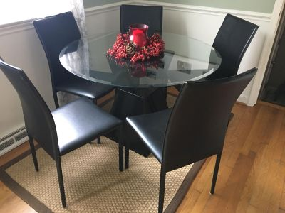 Round glass top table with five chairs