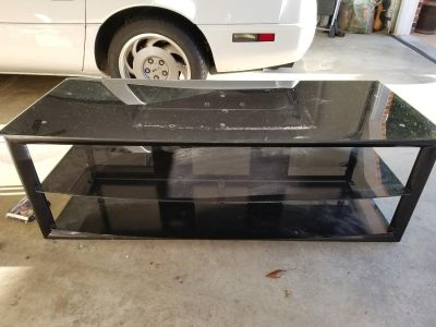 Tv stand made of 3 glass shelves