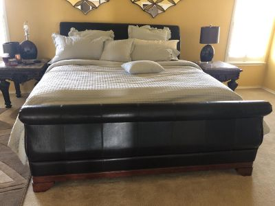 King bed with boxspring and bench.