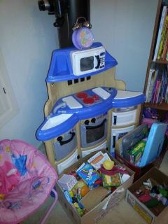 kids kitchen with box of  play food