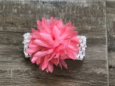 Pink and white flower headband bow.