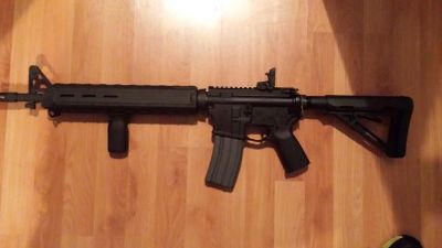 $1,100, New Bushmaster AR-15 with M.O.E furniture