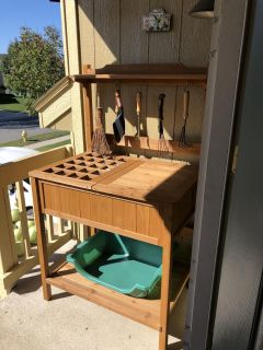 Like NEW with all accessories and tools included- cedar beautiful potting table! 35 wide, 23 deep, 60 tall PRICE FIRM cross posted