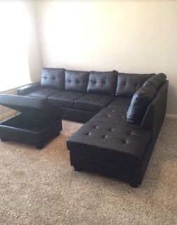 New in Box - 3 pc Reversible sectional with Cupholder and Storage Ottoman