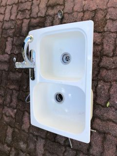 White kitchen sink with faucet