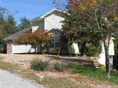 $176,500 3 Level Contempory Home in Holiday Island. Located on the Island and Close to