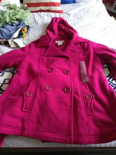 Absolutely darling brand new with tags kind of a Jersey material type jacket