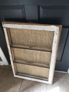 Old window with chicken wire and burlap