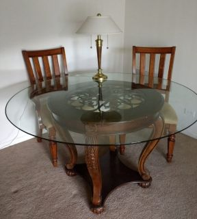 Dining Table (glass top) and 3 chairs (2 with arms).