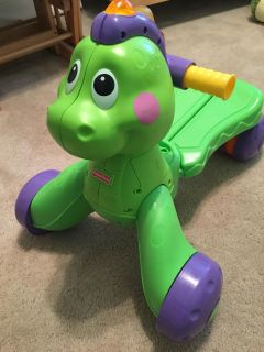 Fisher Price dino ride-on toy