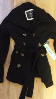 New, never worn.. Womens size Petite Medium, color is Black, jacket. Button front with tie.