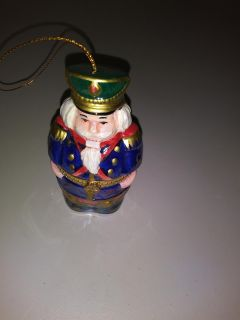 Nutcracker large ornament with music box inside